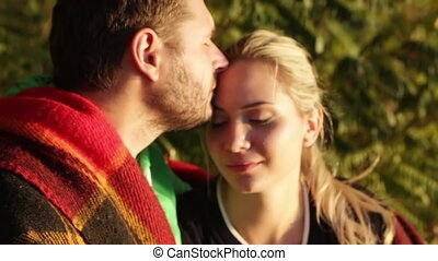 Couple kissing setting sun - Man kissing his woman on sunset...