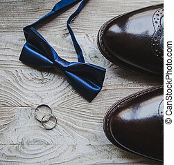 Close up of Wedding details, rings, grooms bow-tie and shoes...