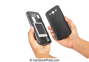 Hand holding smartphone and open backside cover isolated on whit