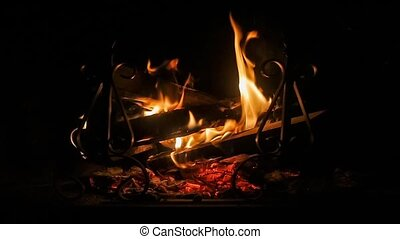wood burning fireplace at night in