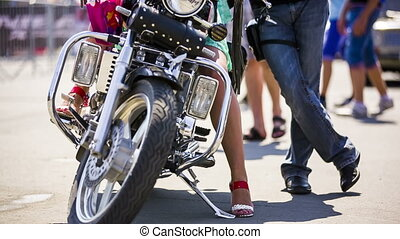 Couple Near Cool Motorcycle - Young girl is on the modern...