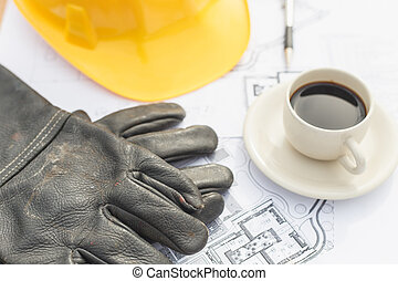 Close up work black glove with coffee, safety helmet and...