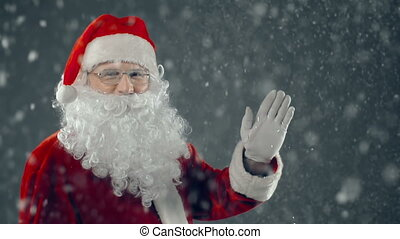 Hello, Kids - Close up of Santa waving and looking at...