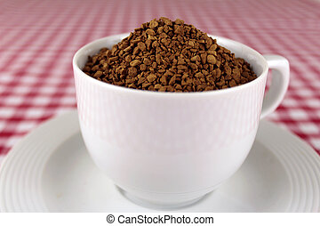instant coffee - coffeecup filled up with instant coffee