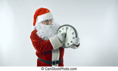 Time Conjure - Santa Claus moving hands of clock forward up...
