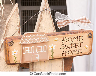 sweet home wooden decoration with bee and daisy hanged on...