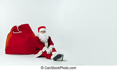 Disabling Burden - Weary Santa falling asleep on the giant...
