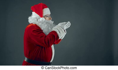 Let it Snow - Santa Claus blowing on his palms thus starting...