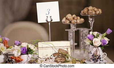 Watch decorated table with flowers - At the wedding table...
