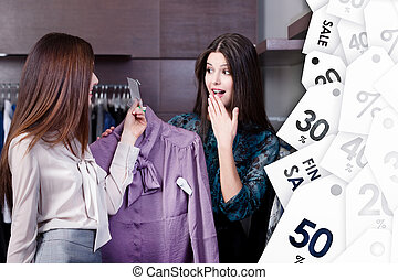 Friends wonder at special prices on sale at the shopping...