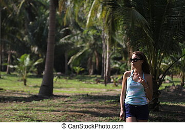 brunette beauty in a rain forest