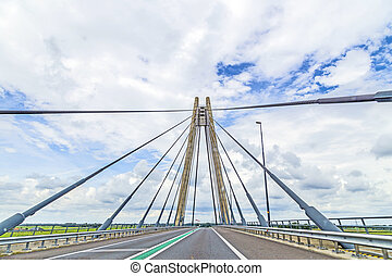 famous bridge in kampen , Netherlands under cloudy sky