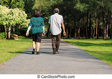 Old people walking in the park
