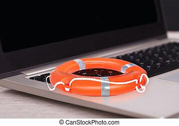 Orange Buoy On Laptop - Closeup of orange buoy on laptop at...