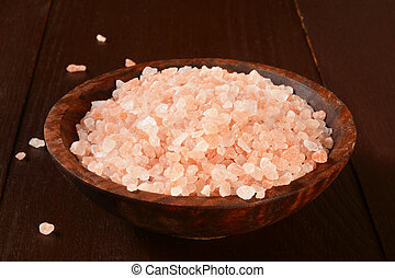 Himalayan Salt Crystals - A wooden bowl of course ground...