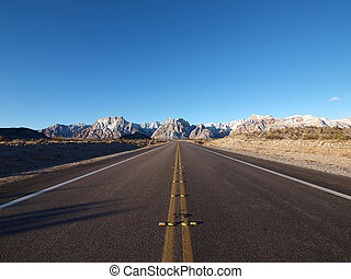 Red Rock Highway - Open highway leading to frost covered...