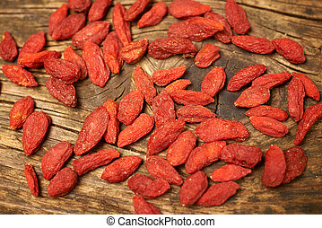 goji berry fruits, on a wooden table