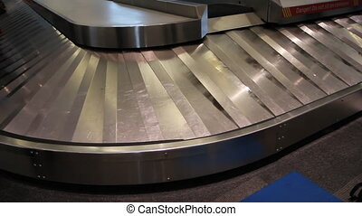 Baggage carousel - Baggage carousel going around, with no...