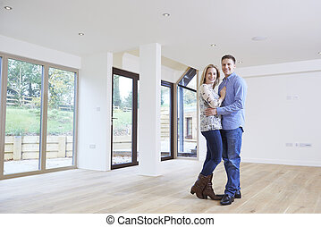 Portrait Of Happy Young Couple In New Home