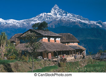 Mt. Machhapuchhre/Mt. Fishtail with typical Nepali houses of...
