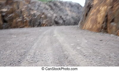 walk forward on way rocks - way is paved among rocks