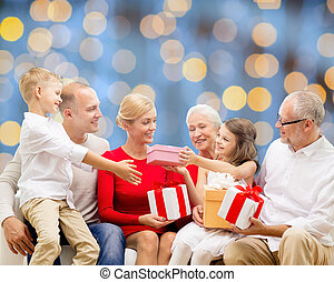 smiling family with gifts - family, holidays, generation,...