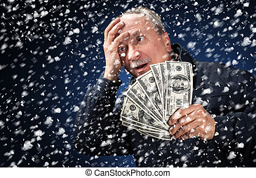man with a bundle of dollars in snowfall - Time to buy...