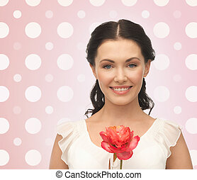 smiling young woman with flower - holidays, people and...