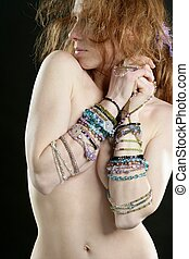 Sexy redhead woman with jewelry around arms - Sexy redhead...