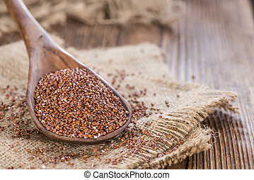 Healthy red Quinoa - Portion of healthy red Quinoa on wooden...