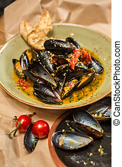 Moules Marinieres - Mussels cooked with white wine sauce -...