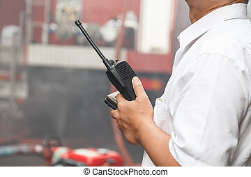 Man using walkie talkie