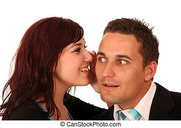 Woman Telling a Secret - Beautiful brunette woman whispering...