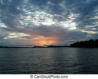 sunset on the Amazon River basin - Deep blue sunset on the...