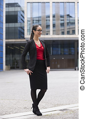Caucasian business woman standing outdoors. - Full-length...
