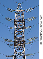 electric line - details of power line with blue sky at...
