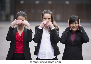 Hear no See no Speak no evil. - Three business women,...