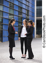 Three Businesswomen outdoors talking - Three Happy Business...