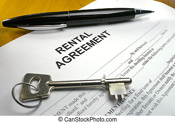 rental agreement with key and pen