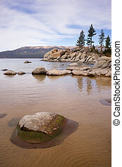 Smooth Rocks Clear Water Lake Tahoe Sand Harbor - A vertical...