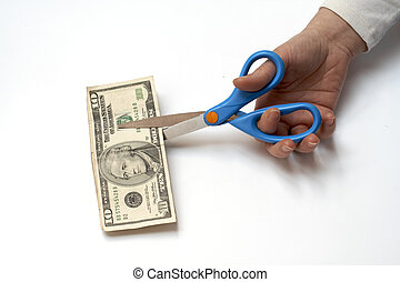 Cutting a ten dollars with scissors