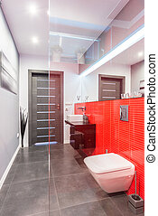Bathroom with red tiled wall