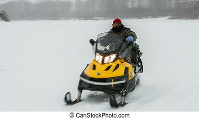 Fisherman on a snowmobile - fisherman on a snowmobile rides...