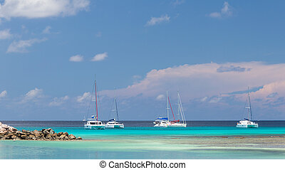 White yachts - Yacht clear turquoise waters of the Indian...