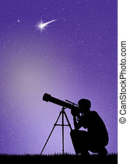 Man looks in the telescope