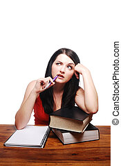 Confused girl sitting at desk with writing pad