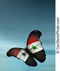 Syrian flag butterfly flying on sky background