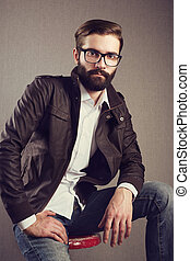 Portrait of handsome man with beard. Fashion photo