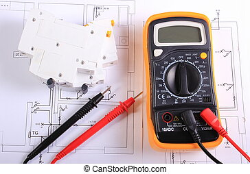 Multimeter and electric fuse on construction drawing -...
