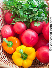 Fresh vegetables in a basket - tomatoes, colorful peppers...